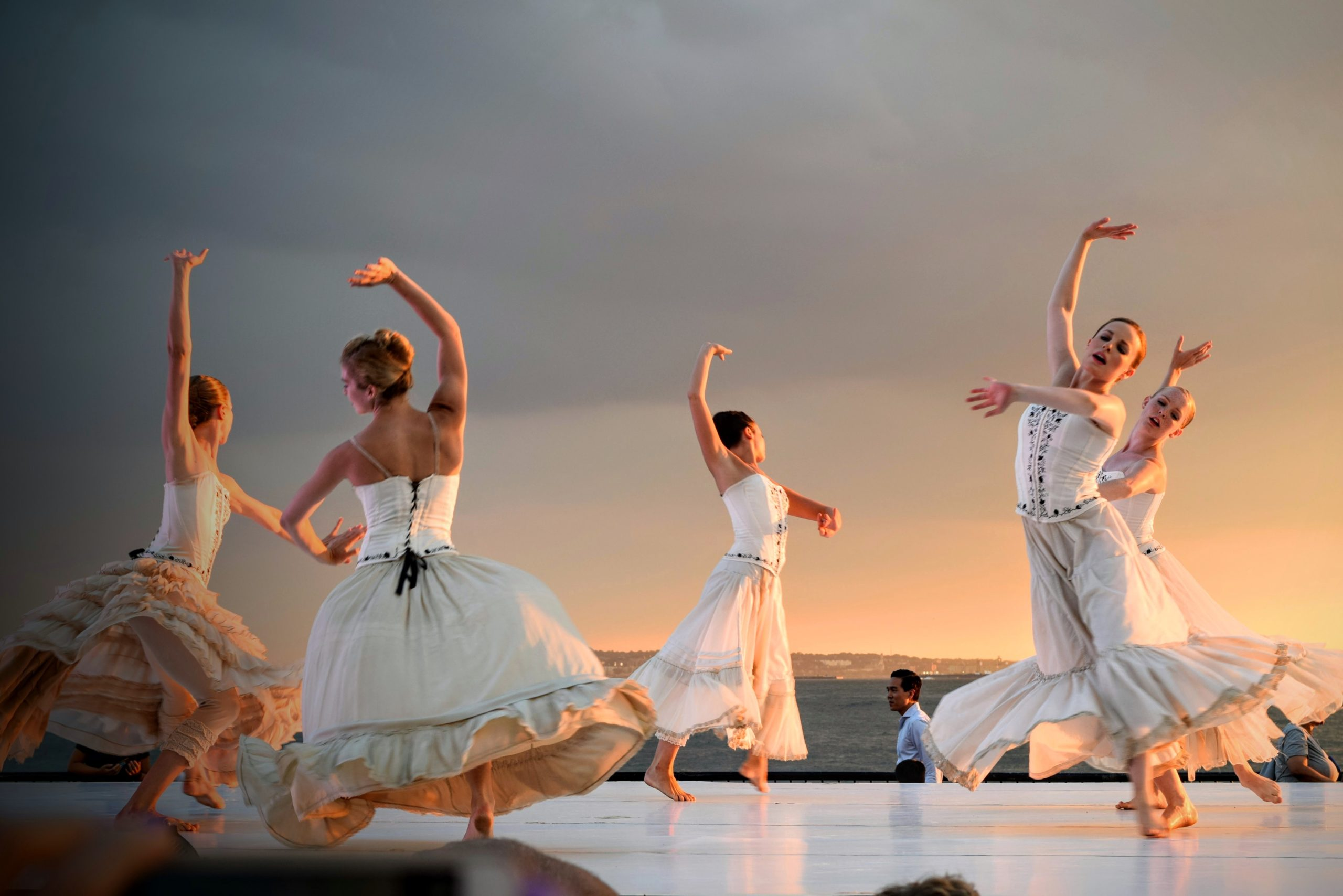 5-women-in-white-dress-dancing-under-gray-sky-during-sunset-175658